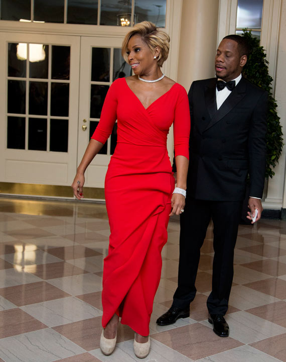 Singer Mary J. Blige, and Kendu Isaacs, left, arrive for a State Dinner in honor of French President Fran?ois Hollande, at the White House in Washington, Tuesday, Feb. 11, 2014. (AP Photo/Manuel Balce Ceneta)