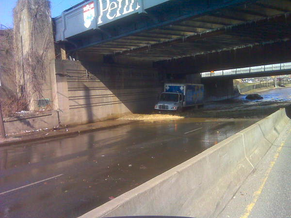 Another viewer photo shows a truck coming through the water that has flooded the roadway underneath a railroad bridge.