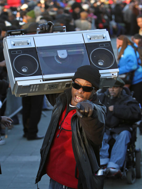 Anthony Brown carries a boom-box while participating in the Soul Train dance line record attempt, Monday Feb. 13, 2012, in Philadelphia. (AP Photo/ Joseph Kaczmarek)