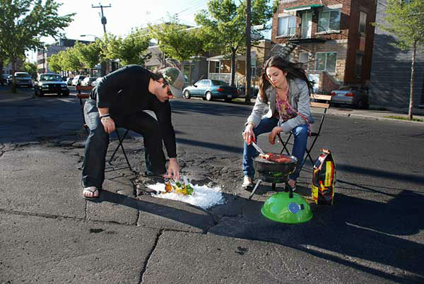 "Husband and wife photographers Davide Luciano and Claudia Ficca created this series called ""Potholes.""   From their website:   ""Potholes is a series of photographs depicting the concave street cracks and holes as a collection of imaginative tableaux in the city. Captured within the backdrops of New York City, Los Angeles, Toronto and Montreal, the sets explore the urban flaws as a playground creating a multitude of uses out of the potholes. Directly engaging the street and the city, the highly imaginative series transforms the bad into good, creating a tongue-in-cheek collection that is at once contextual and surreal. ""  (Photos used here with permission)"