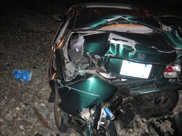 "<div class=""meta ""><span class=""caption-text "">It happened just after 4:00 a.m. on Thursday February 23, 2012 on the CSX railroad tracks at West Main Street and New London Road in Newark, Delaware. Newark Police say a green Honda sedan driven by Monique Dyton of New Castle, Del. became stuck on the tracks after Dyton made a wrong turn.  No one was injured.</span></div>"