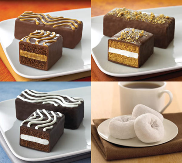 "<div class=""meta ""><span class=""caption-text "">Tastykake turns 100  Kandy Bar Kakes:  Peanut Butter: Made with Real Reese's? Peanut Butter S'Mores: Made with Real Hershey's? Cocoa and topped with Graham cracker crumbles Almond Joy? Kandy Bar Kake Peppermint: Made with Real York? Peppermint Flavor  -------  Donuts:    MULTI SERVE BOXED DONUTS  Cinnamon Assorted Donuts Glazed Donut Holes Powdered Sugar Mini Donuts Rich Frosted Assorted Donuts Rich Frosted Mini Donuts Seasonal Donut Holes   MULTI SERVE BAG DONUTS  Cinnamon Mini Donuts Powdered Sugar Mini Donuts Rich Frosted Mini Donuts  SINGLE SERVE DONUTS  Coconut Crunch Mini Donuts Powdered Sugar Mini Donuts Rich Frosted Mini Donuts  (tastykake.com)</span></div>"