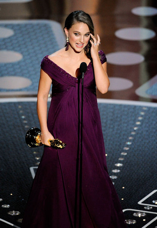 "Actress Natalie Portman accepts the award for best actress in ""The Black Swan"" during the 83rd Academy Awards on Sunday, Feb. 27, 2011, in the Hollywood section of Los Angeles. (AP Photo/Mark J. Terrill)"
