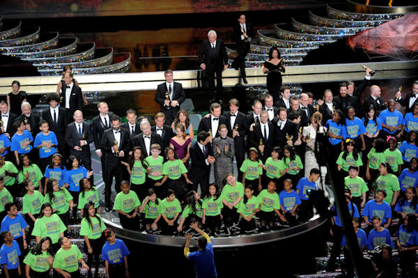Show hosts, James Franco, center left, and Anne Hathaway, center right, along with all of the award winners, and the kids of the PS22 Chorus are seen during the 83rd Academy Awards on Sunday, Feb. 27, 2011, in the Hollywood section of Los Angeles. (AP Photo/Mark J. Terrill)
