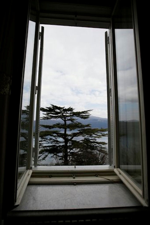 An open window inside a hall of pope's summer residence of Castel Gandolfo, in the town of Castelgandolfo, south of Rome, Wednesday, Feb. 20, 2013. Immediately after his resignation on Feb. 28, 2013, Pope Benedict XVI will spend some time at the papal summer retreat in Castel Gandolfo, overlooking Lake Albano in the hills south of Rome where he has spent his summer vacations reading and writing. (AP Photo/Gregorio Borgia)