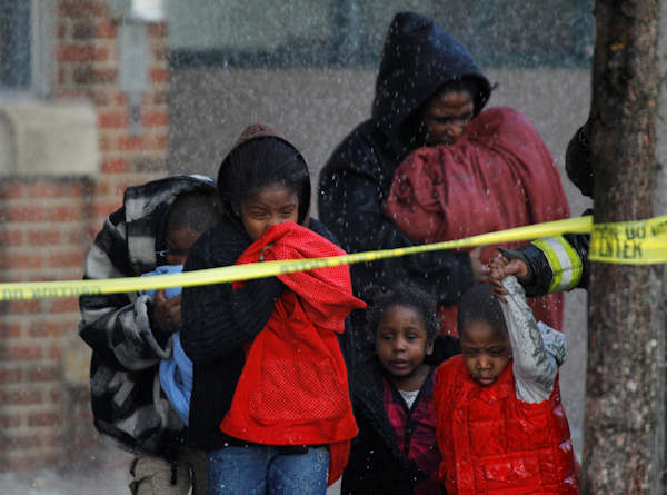 People are evacuated from a fire at a Philadelphia Housing Authority building in Philadelphia, Wednesday, March 2, 2011.  (AP Photo/Matt Rourke)