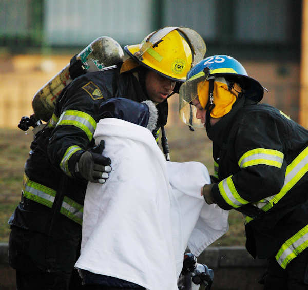 "<div class=""meta ""><span class=""caption-text "">Firefighters wrap an evacuated child in a blanket at the scene of a fire at a Philadelphia Housing Authority building in Philadelphia, Wednesday, March 2, 2011.  (AP Photo/Matt Rourke)</span></div>"