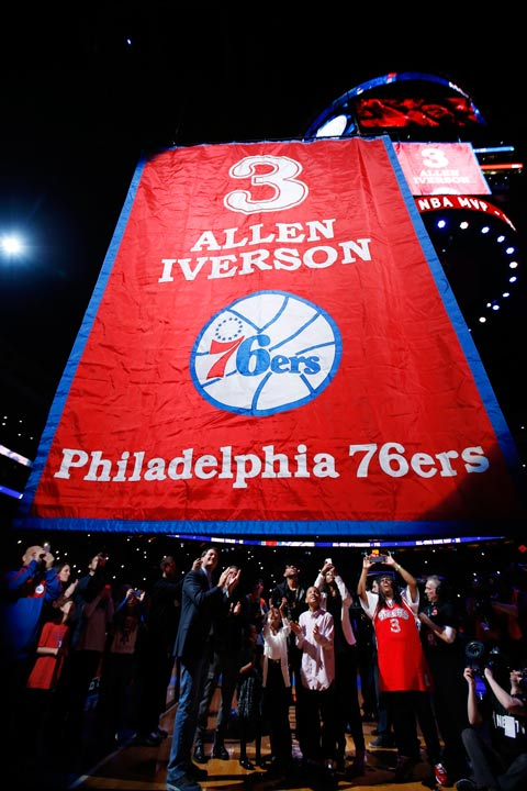 Former Philadelphia 76er Allen Iverson, center, watches as a banner with his number is raised during a retirement ceremony at halftime of an NBA basketball game between the 76ers and the Washington Wizards, Saturday, March 1, 2014, in Philadelphia. (AP Photo/Matt Slocum)