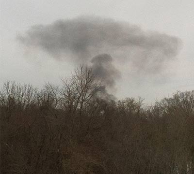 This viewer-submitted photo from Washignton Crossing, Pa. shows the cloud of smoke after an explosion and fire in Ewing Township, New Jersey, about 5 miles away.