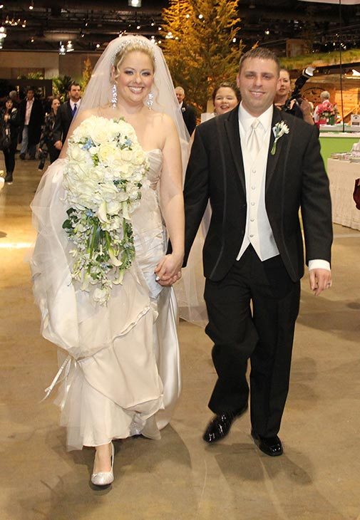 The couple heads off to the reception at the Tourism Ireland exhibit in the Flower Show. They won the all-expenses-paid wedding ceremony, courtesy of PHS, and a honeymoon to Ireland, courtesy of Tourism Ireland, based on a nominating letter written by Roxanne about her then-fiance Frank. (Photo Courtesy: ThePennsylvania Horticultural Society, the Philadelphia Flower Show and Philadelphia Wedding magazine)