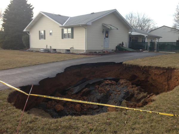 "<div class=""meta image-caption""><div class=""origin-logo origin-image ""><span></span></div><span class=""caption-text"">A massive sinkhole, at least 30 feet wide and 15 feet deep, was discovered on Wilson Avenue between 2nd and 3rd streets in Bethlehem Township, Northampton County. The sinkhole swallowed part of the driveway of a home and forced emergency crews to evacuate the family who living in the home. Read more on this story.</span></div>"