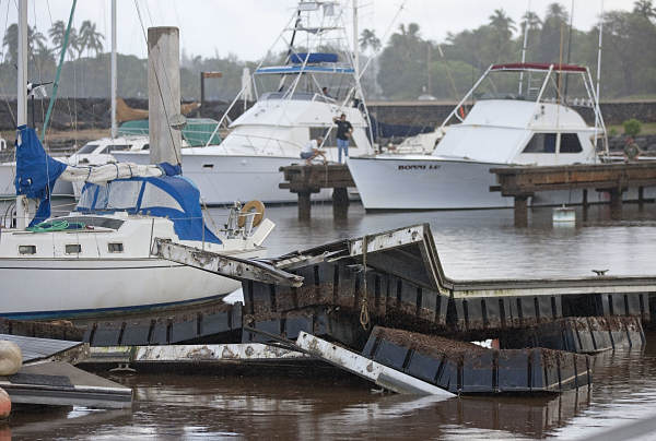The tsunami surge in the Haleiwa Boat Harbor damaged several docks Friday, March 11, 2011 in Honolulu. A large 8.9 earthquake struck Japan and generated a tsunami which made it&#39;s way past Hawaii and eventually hit the west coast of the United States.  <span class=meta>(AP Photo&#47;Eugene Tanner)</span>