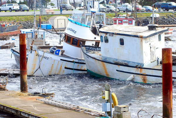 Fishing boats crash into one another Friday, March, 11, 2011 in the boat basin at Crescent City, Calif., as one of a series of tsunami surges slams into the harbor, breaking up docks and tearing lose boats. An 8.9-magnitude earthquake in Japan sparked a tsunami that sped across the Pacific and caused tsunami warnings as far away as the west coast of the United States. <span class=meta>(AP Photo&#47;Jeff Barnard)</span>