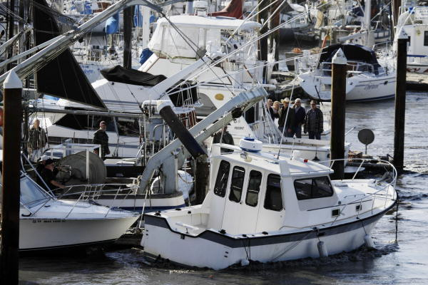 A boat ripped from its anchor by a tsunami surge crashes into boats on the harbor in Santa Cruz, Calif., Friday, March 11, 2011. A ferocious tsunami unleashed by Japan&#39;s biggest recorded earthquake slammed into its eastern coast Friday, killing hundreds of people as it carried away ships, cars and homes, and triggered widespread fires that burned out of control. Hours later, the waves washed ashore on Hawaii and the U.S. West coast, where evacuations were ordered from California to Washington but little damage was reported. The entire Pacific had been put on alert _ including coastal areas of South America, Canada and Alaska _ but waves were not as bad as expected.  <span class=meta>(AP Photo&#47;Marcio Jose Sanchez)</span>