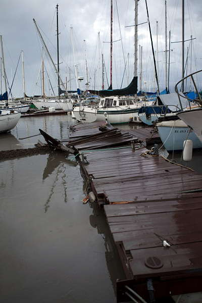 A damaged pier is shown after a tsunami hit Hawaii on Friday, March 11, 2011 in Honolulu. A tsunami generated by an 8.9-magnitude earthquake in Japan hit Oahu causing some damage around the island.  <span class=meta>(AP Photo&#47;Marco Garcia)</span>