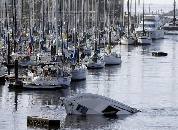 "<div class=""meta image-caption""><div class=""origin-logo origin-image ""><span></span></div><span class=""caption-text"">A boat sinks into the ocean in the aftermath of the surge caused by a tsunami on the harbor in Santa Cruz, Calif., Friday, March 11, 2011. A ferocious tsunami unleashed by Japan's biggest recorded earthquake slammed into its eastern coast Friday, killing hundreds of people as it carried away ships, cars and homes, and triggered widespread fires that burned out of control. Hours later, the waves washed ashore on Hawaii and the U.S. West coast, where evacuations were ordered from California to Washington but little damage was reported. The entire Pacific had been put on alert _ including coastal areas of South America, Canada and Alaska _ but waves were not as bad as expected.  (AP Photo/Marcio Jose Sanchez)</span></div>"