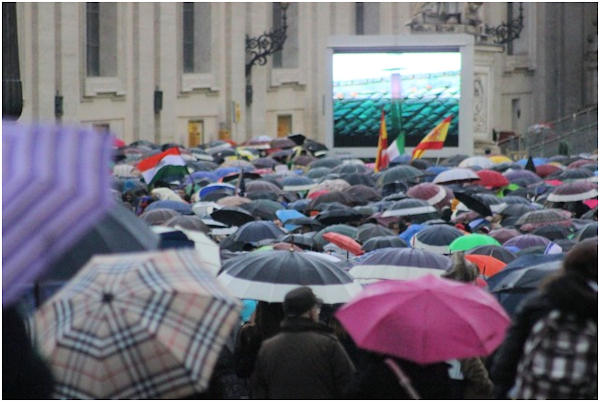 "<div class=""meta ""><span class=""caption-text "">Wednesday, March 13, 2013: Rain could not keep the faithful away from St. Peter's Square.  Photo from Action News executive producer John Morris.</span></div>"
