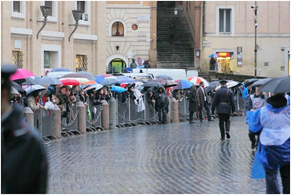 Wednesday, March 13, 2013: Rain could not keep the faithful away from St. Peter's Square.  Photo from Action News executive producer John Morris.