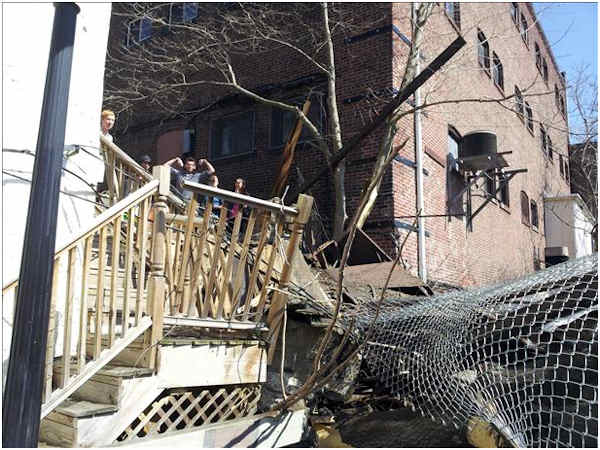 "<div class=""meta ""><span class=""caption-text "">A tree fell across the Manayunk Towpath Monday afternoon, March 19, 2012, damaging a section of the walkway and hitting a freight train. It happened at 2:00 p.m. just off Main Street near Cotton Street.  No one was injured.    (Action News Viewer Steven Hass)</span></div>"