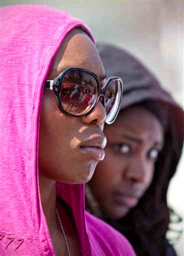 "<div class=""meta ""><span class=""caption-text "">Ifeoma Ike, left, who works for the House Judiciary Committee, and Nina Smith, right, of Impact DC, join in the ""Hoodies on the Hill"" event to remember Trayvon Martin, the unarmed black teenager who was shot in Sanford, Fla., as he was wearing a hooded sweatshirt, on Capitol Hill in Washington, Friday, March 23, 2012. (AP Photo/J. Scott Applewhite)</span></div>"
