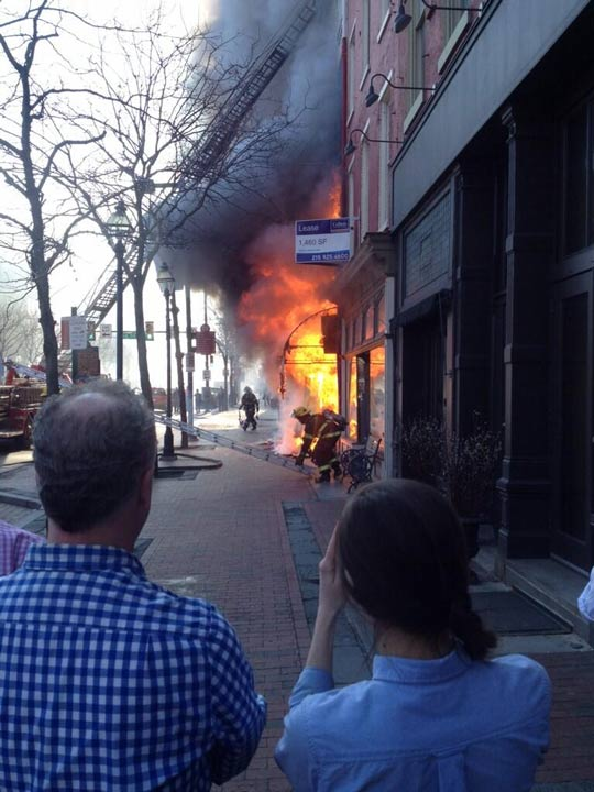 Fire broke out at the Suit Corner building in Old City on Wednesday morning, April 9, 2014. (Photo courtesy of William Reed @underservedphil)