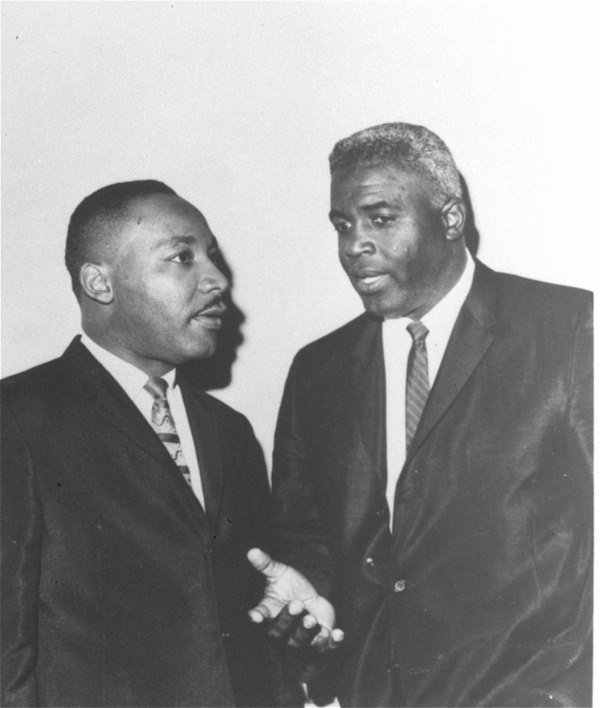 "<div class=""meta ""><span class=""caption-text "">Dr. Martin Luther King, Jr. is shown with Jackie Robinson in the 1960s. Jackie Robinson's impact in business, politics, and civil rights was a large part of ""Jackie Robinson: An American Journey"", the Coca-Cola USA-sponsored exhibition at The New York Historical Society. (AP Photo/Coca-Cola USA)  </span></div>"