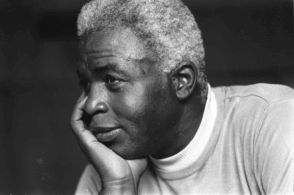 FILE - In this June 30, 1971 file photo, Jackie Robinson poses at his home in Stamford, Conn.  (AP Photo/File)