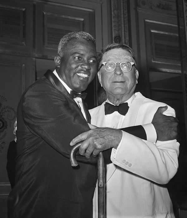 FILE - In this July 20, 1962 file photo, baseball player Jackie Robinson embraces Branch Rickey in New York. Rickey was general manager of the Brooklyn Dodgers when Robinson was hired. (AP Photo/File)