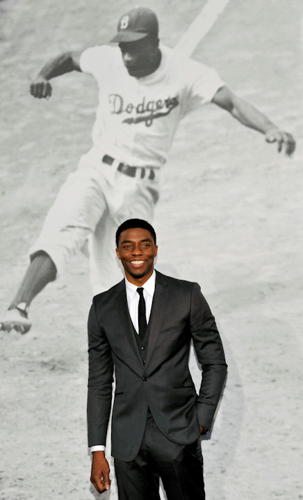 "<div class=""meta ""><span class=""caption-text "">Chadwick Boseman, who plays baseball legend Jackie Robinson in ""42,"" poses at the Los Angeles premiere of the film at the TCL Chinese Theater on Tuesday, April 9, 2013 in Los Angeles. (Photo by Chris Pizzello/Invision/AP)  </span></div>"