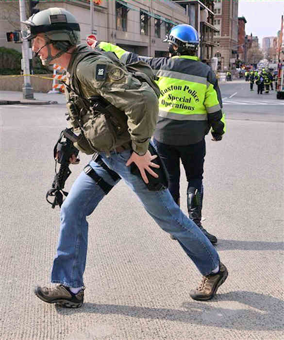 "<div class=""meta ""><span class=""caption-text "">An armed FBI agent passes a Boston police officer following an explosion at the finish line of the 2013 Boston Marathon in Boston, Monday, April 15, 2013. Two explosions shattered the euphoria of the Boston Marathon finish line on Monday, sending authorities out on the course to carry off the injured while the stragglers were rerouted away from the smoking site of the blasts.  (AP Photo/Josh Reynolds)</span></div>"