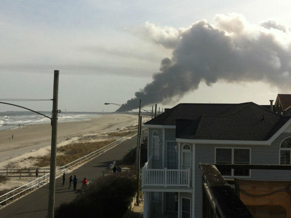 "<div class=""meta ""><span class=""caption-text "">Action News viewers captured photos of the flames and smoke in Sea Isle, New Jersey on April 18, 2014. (Action News Viewer via Sendit.6abc.com)</span></div>"