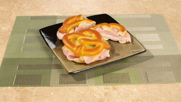 Monte Cristo Pretzelwich  &#40;Yields: 12 Servings&#41;    Ingredients  12 SUPERPRETZEL Soft Pretzels  24 slices ham 24 slices turkey or chicken  24 slices Swiss cheese Mustard or dressing &#40;optional&#41;  Butter  Batter:  6 eggs 2&#47;3 cup milk  1&#47;4 teaspoon salt     Directions:   1.Bake the SUPERPRETZELS according to the box instructions. Slice horizontally each of the pretzels.    2.Layer with 2 slices of ham and 2 slices of turkey or chicken.  3.Spread with mustard or other dressing &#40;if desired&#41;.   4.Place 2 slices of cheese on top.    5.Top each sandwich with top half of SUPERPRETZEL and secure with toothpicks.   6.To create the batter, beat eggs with milk and salt.   7.Dip the sandwich into the egg mixture and fry on a hot skillet or griddle in butter.   8.Brown on both sides, adding more butter when necessary.    9.Remove toothpicks before serving.  <span class=meta>(Photo&#47;SuperPretzel)</span>
