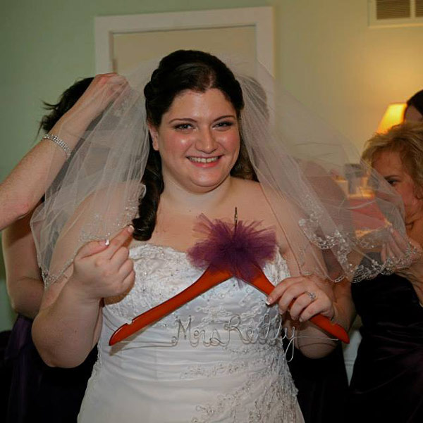 A Montgomery County mother of the bride wants to find two strangers who crashed her daughter's wedding in Valley Forge.  Pictured here is the bride.