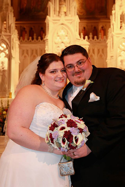 A Montgomery County mother of the bride wants to find two strangers who crashed her daughter's wedding in Valley Forge.  Pictured here is the bride and groom.
