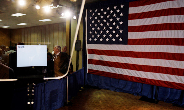 """Lead,"" the last word of Democratic presidential hopeful Sen. Barack Obama D-Ill., left, speech can be seen on the TelePrompTer after he spoke about Iraq and national security, Wednesday, March 19, 2008, at Fayetteville Technical Community College in Fayetteville, N.C. (AP Photo/Alex Brandon)"