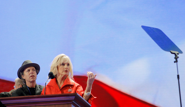 Cindy McCain, wife of Republican presidential candidate Sen. John McCain, R-Ariz., and Mark McKinnon, chief media adviser for Sen. McCain, left, look at the teleprompter during a walk through at the Republican National Convention in St. Paul, Minn., Wednesday, Sept. 3, 2008. (AP Photo/Jae C. Hong)