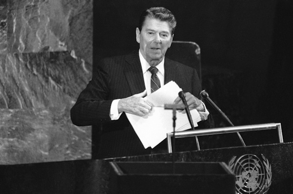 President Ronald Reagan, standing behind a teleprompter, picks up his speech following his address to the 39th session of the United Nations General Assembly, on Monday, Sept. 24, 1984. (AP Photo/David Pickoff)