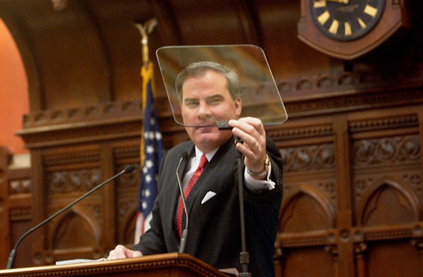 Connecticut Gov. John G. Rowland adjusts his TelePrompTer in the Hall of the House at the state Capitol in Hartford, Conn., Wednesday, Jan. 8, 2003. Rowland was to give his state-of-the-state address in the chamber later in the day to a joint session of the Connecticut General Assembly. (AP Photo/Bob Child)