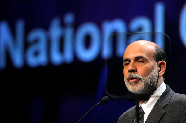 Federal Reserve Board Chairman Ben Bernanke is seen through a teleprompter as he speaks during the Independent Community Bankers of America convention in Las Vegas on Wednesday, March 8, 2006. Bernanke said the growth in commercial real estate loans by community banks bears watching. (AP Photo/Jae C. Hong)