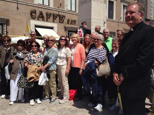 "<div class=""meta image-caption""><div class=""origin-logo origin-image ""><span></span></div><span class=""caption-text"">A group of 50 local Catholics traveled to Rome with the Archdiocese of Philadelphia for the historic canonization ceremony.</span></div>"