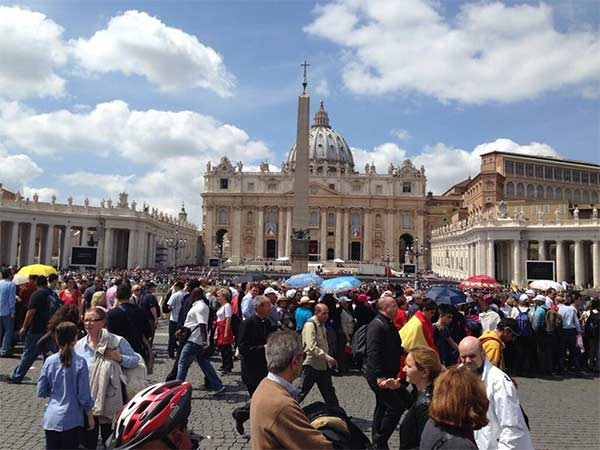 "<div class=""meta image-caption""><div class=""origin-logo origin-image ""><span></span></div><span class=""caption-text"">A busy Saint Peter's Square the day before the canonization ceremony on Sunday</span></div>"