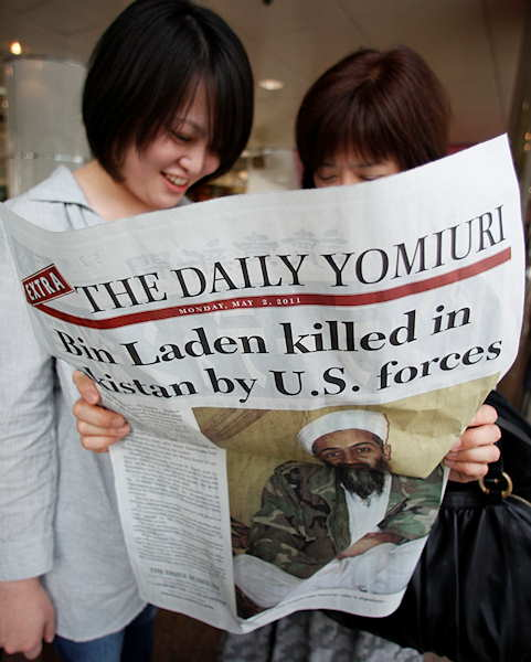 "<div class=""meta ""><span class=""caption-text "">Women reads the extra edition of a Japanese newspaper in Tokyo Monday, May 2, 2011, reporting Osama bin Laden, the glowering mastermind behind the Sept. 11, 2001, terror attacks was killed in an operation led by U.S. forces.  (AP Photo/Shizuo Kambayashi)</span></div>"