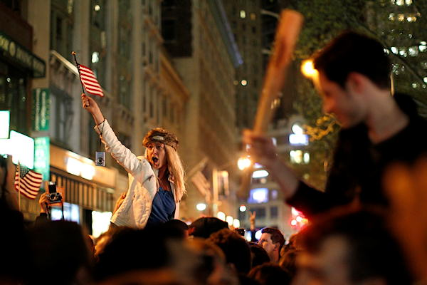 "<div class=""meta ""><span class=""caption-text "">A large, jubilant crowd reacts to the news of Osama bin Laden's death at the corner of Church and Vesey Streets, adjacent to ground zero, during the early morning hours of Tuesday, May 2, 2011 in New York.  (AP Photo/Jason DeCrow)</span></div>"