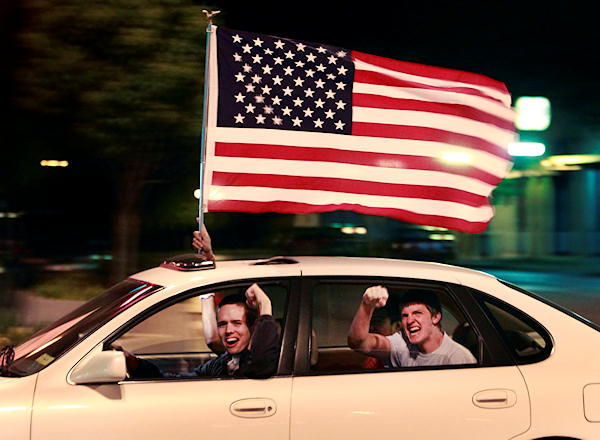A driver and passengers celebrate the death of Osama bin Laden in the streets of Lawrence, Kan., Sunday, May 1, 2011. President Barack Obama announced Sunday night, May 1, 2011, that Osama bin Laden was killed in an operation led by the United States. <span class=meta>(AP Photo&#47;Orlin Wagner)</span>