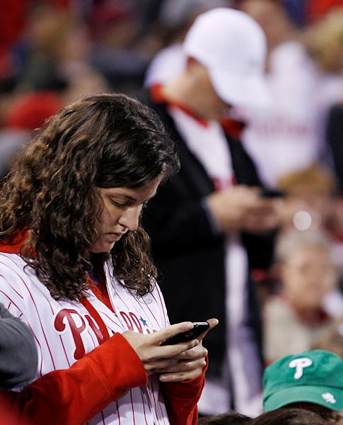 "<div class=""meta ""><span class=""caption-text "">Fans check their cell phones during a baseball game between the Philadelphia Phillies and the New York Mets, Sunday, May 1, 2011, in Philadelphia. New York won 2-1 in 14 innings. News broke during the game that Osama bin Laden had been killed.  (AP Photo/Matt Slocum)</span></div>"