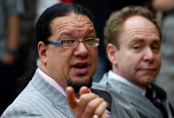 Penn Jillette named his daughter Moxie CrimeFighter. In this photo, U.S. illusionists and magicians Penn Jillette, left, and Raymond Teller talk a tv media before their performance at Westfield Shopping centre in London to promote their 5 night Penn & Teller shows, Tuesday, July 13, 2010. (AP Photo/Sang Tan)