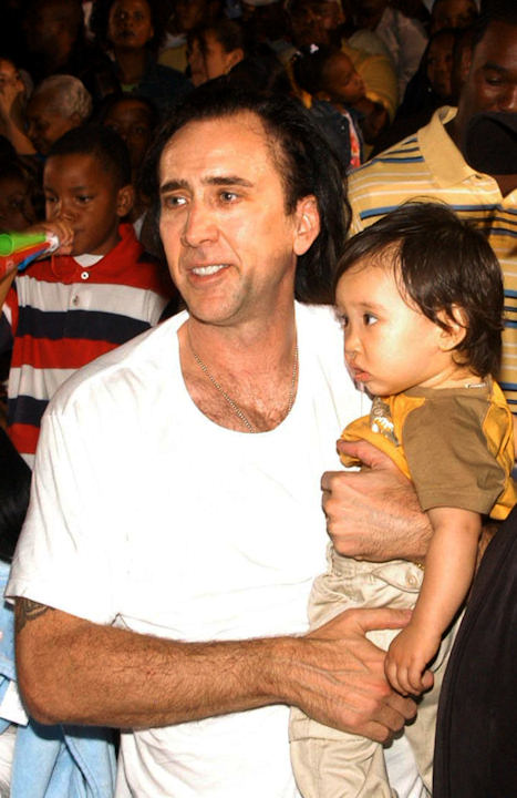 Actor Nicholas Cage named his son Kal-el . In this Dec. 21, 2006, photo, Cage holds Kal-el as they watch a street festival for kids in Nassau, Bahamas. (AP Photo/Letisha Henderson)
