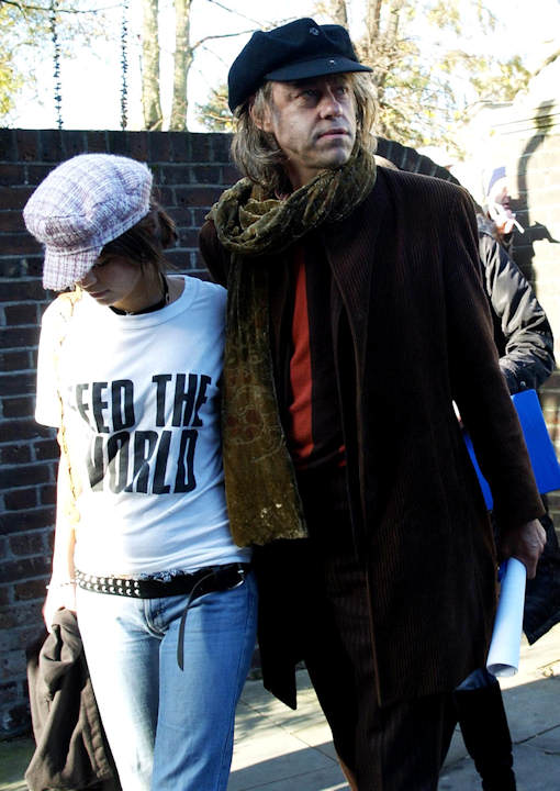 "Sir Bob Geldof arrives with his daughter Fifi Trixibell at the Air recording studios in Hampstead, London, Sunday Nov. 14, 2004, to record ""Do They Know It's Christmas"" as part of Band Aid 20, 20 years after the first version of the song raised millions for famine relief in Africa. (AP Photo/Max Nash)"