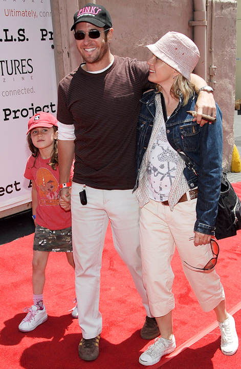Actor Rob Morrow named his daughter Tu Morrow. In this photo, Rob, center, with wife Debbon Ayer, right, and daughter Tu Simone Ayer Morrow, left, poses on the press line at the sixth annual Project A.L.S. benefit block party in Los Angeles, Saturday, May 12, 2007. (AP Photo/Dan Steinberg)