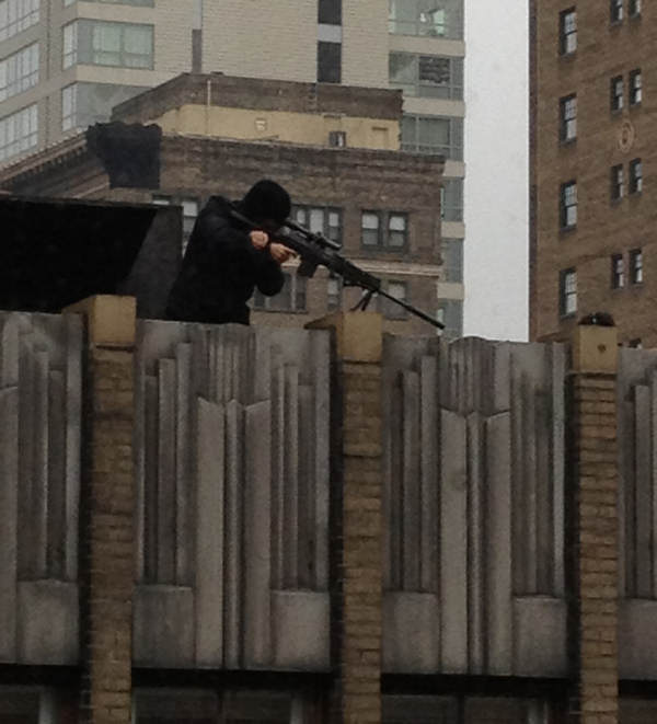 Production crews for the movie &#34;Dead Man Down&#34; moved to the rooftops on Thursday at 17th and Walnut streets in Center City Philadelphia. Here you can see actor Colin Farrell handling a rifle during the filming of a scene. This picture was taken by Action News viewer Justin Bresson. <span class=meta>(Dead Man Down movie shoot in Philadelphia)</span>